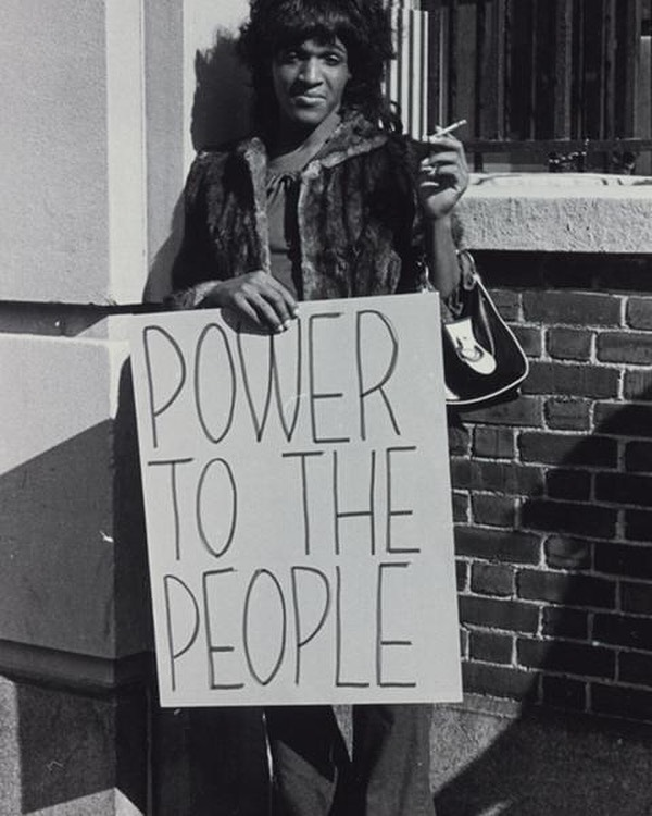 Marsha Johnson with Power to the People sign
